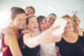 Laughing group of senior women standing