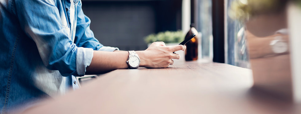 man-using-smartphone-during-leisure-time