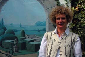Ruth in her town garden with mural