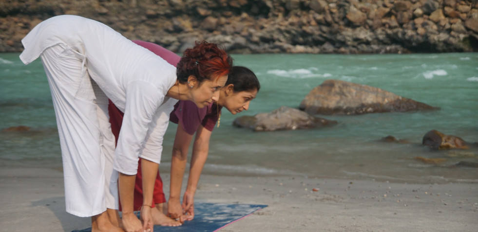 Yoga Asanas at the shores of the holy river Ganga