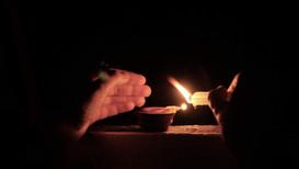Lightning the diya (Diwali Festival)