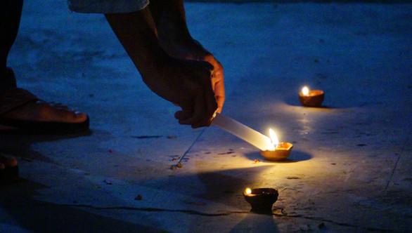 Lightning the diyas for Diwali