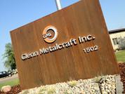 GMI-exterior-sign-rusted-metal.jpg