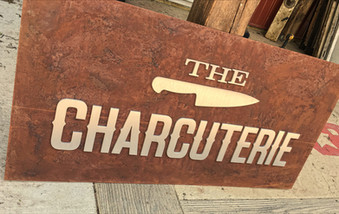 Charcuterie-Restaurant-Sign-rusted-steel