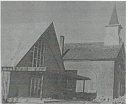 New St. John Lutheran Church Metropols, IL Standing Next to Old Brick Church