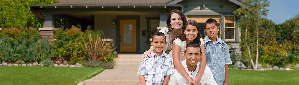 Happy family in front of beautiful home