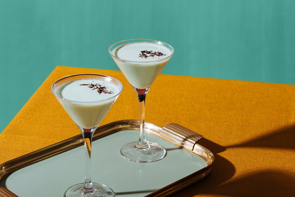 2 cocktail glasses filled with white creamy cocktails