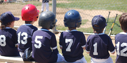 Children in baseball uniforms