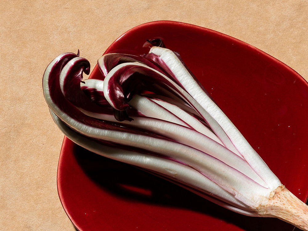 Purple-white radicchio on a red plate