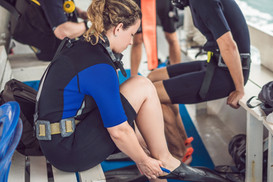 Scuba diver getting ready on boat