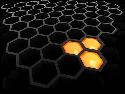 A graphic of over 30 hexagons that are filled with black, in the formation seen in a bee hive; three of the hexagons are filled with bright orange and yellow coloring.