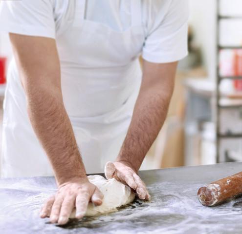Chef kneading dough for tortilla