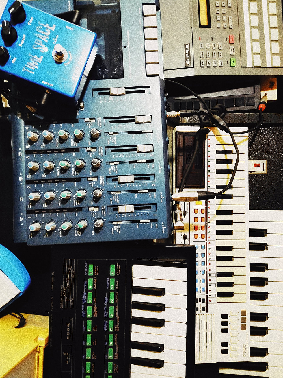 Topshot of electronic keyboard instruments and sound console