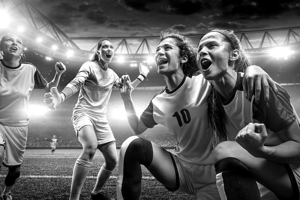Equipo de fútbol femenino victorioso