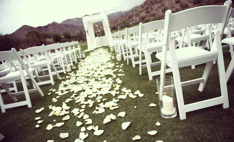 White Padded Chairs Wedding Ceremony