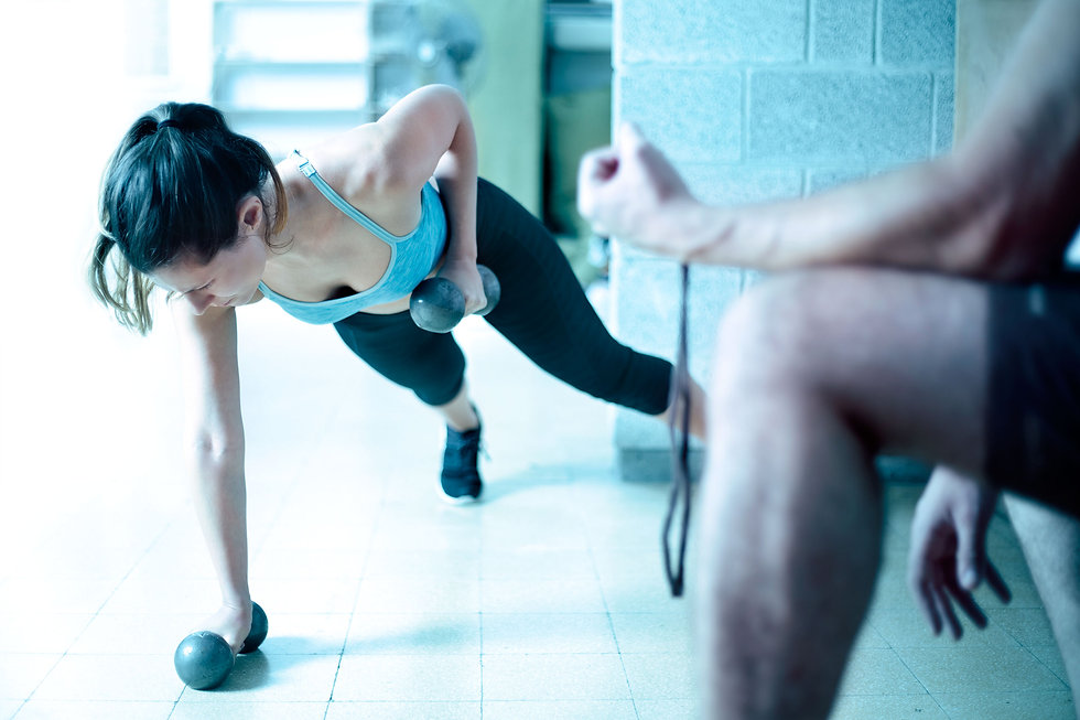 Woman Training with a Physiotherapist