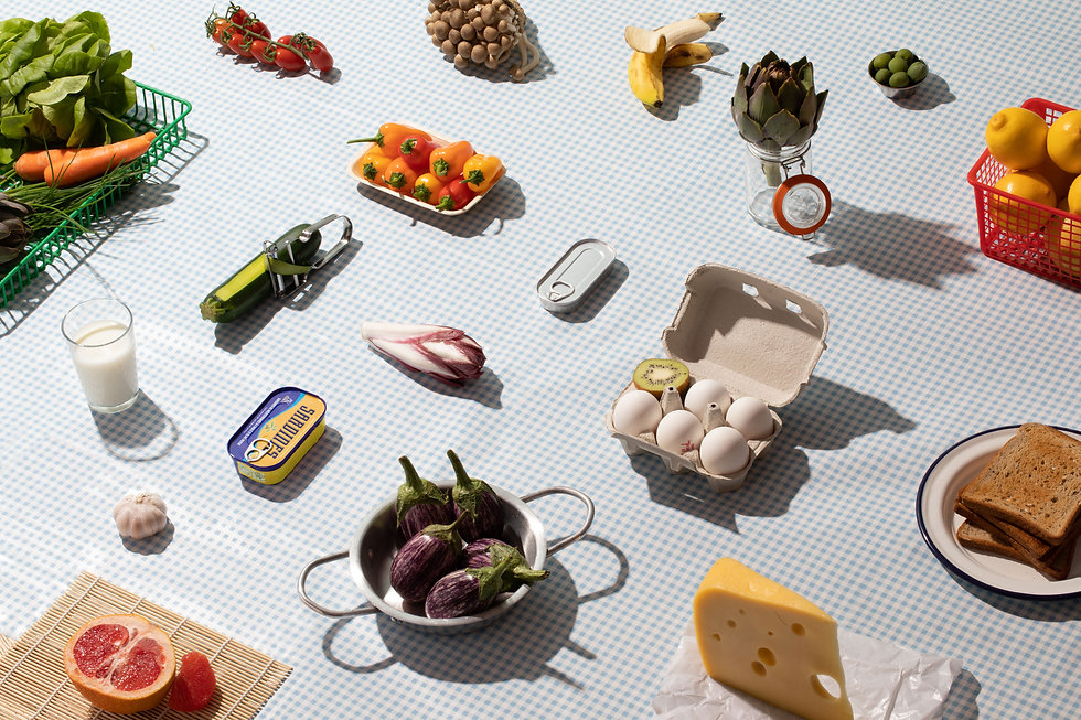Composition of food product and vegetables over checkered background
