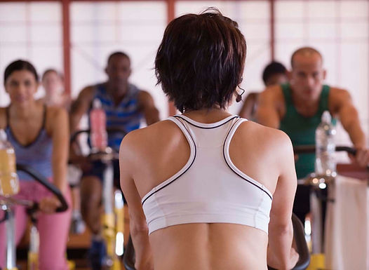 instructor leading a spin class