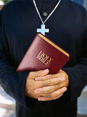 Picture of Holy Bible in a person's hands.