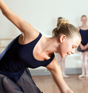 Smiling young girl during ballet class