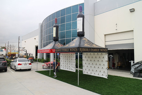 10x10 custom pop up canopies with inflatable wine bottles riboli