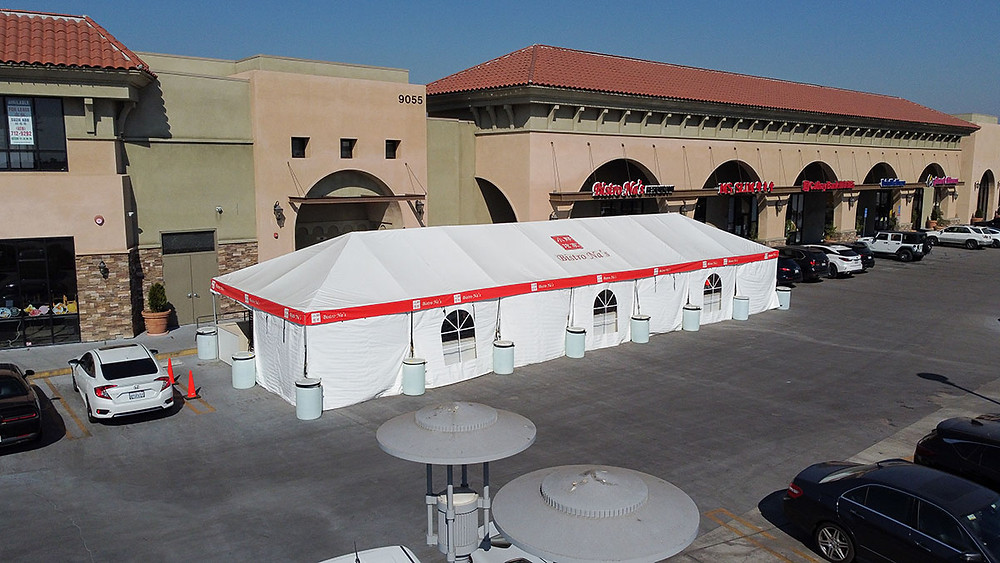 Large white restaurant frame tent with walls and clear windows
