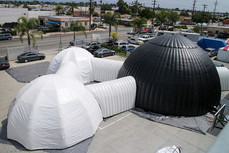 Giant inflatable white and black dome event tents connected with tunnels