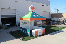 10x10 custom pop up canopy with inflatable smile California