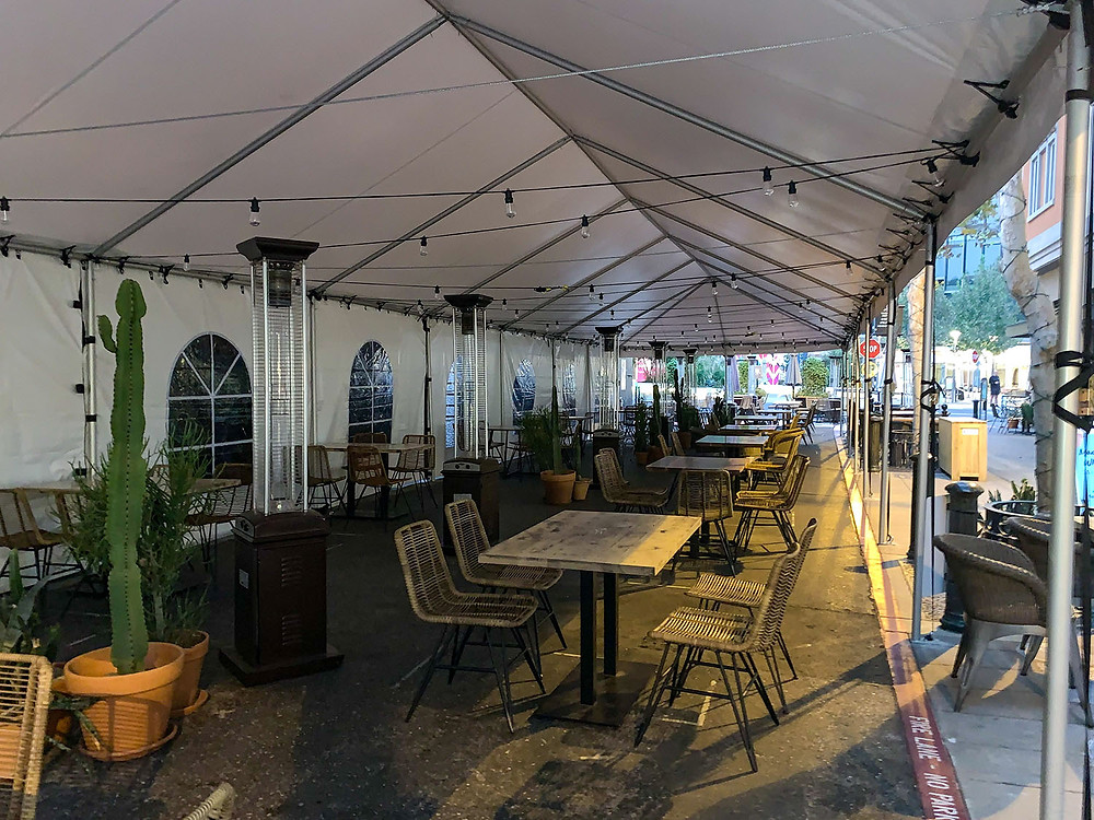 Large commercial frame tent with patio heaters