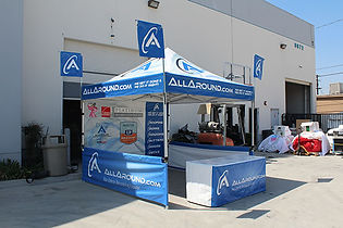 10x10 Printed canopies, table covers and flags with company logos All Around
