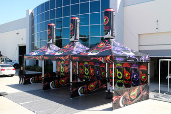 10x10 Branded pop up canopies with inflatable bang energy drink cans