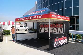 10x15 Custom printed tent with Logos Sunridge Nissan Dealer