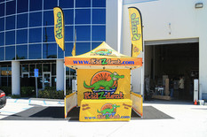 10x10 Advertising pop up tent with printed flags and table cover Kidzdent