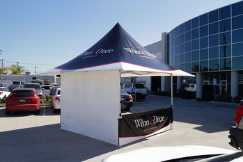 12x12 personalized parasol canopy with back wall Winn Dixie