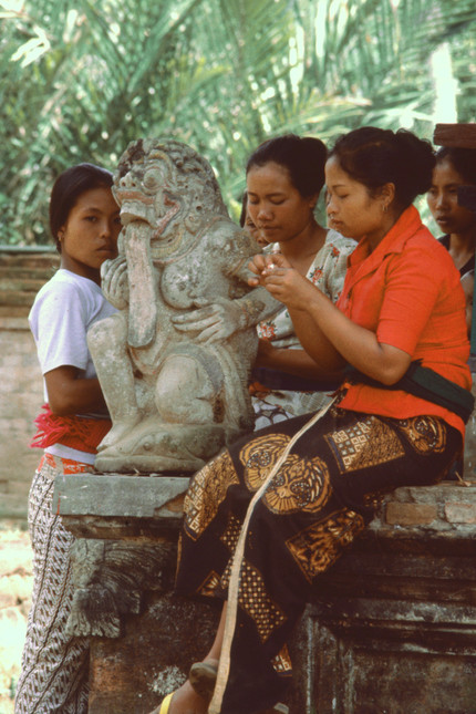Girls relaxing in temple