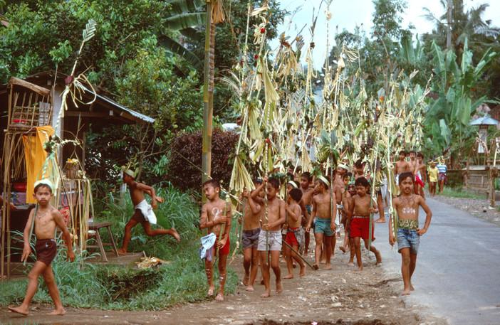 Children imitating adult procession