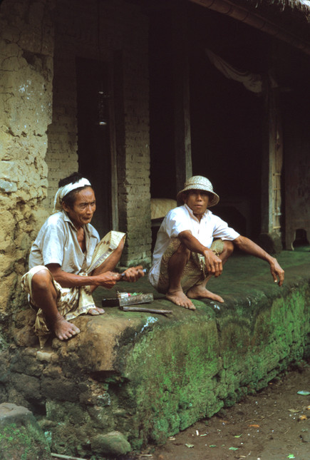 Two men squatting