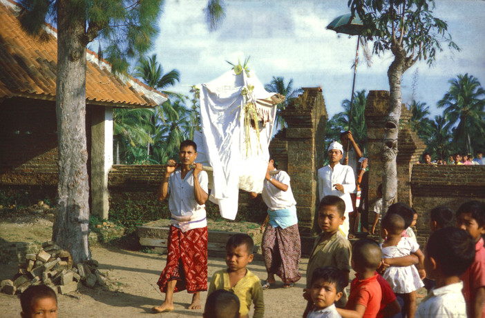 Temple priest with palanquin