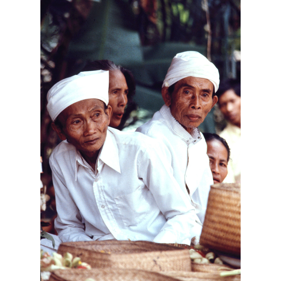 Two temple priests during a moment's res