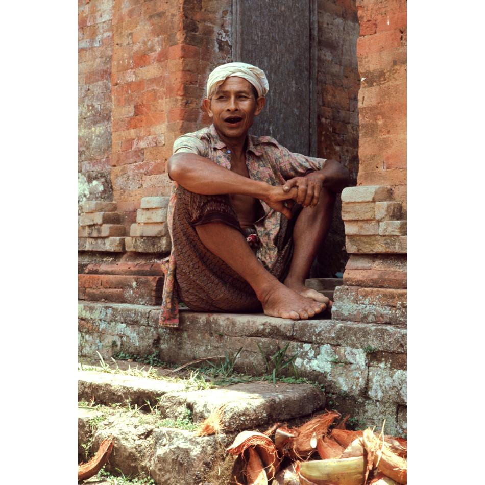 Villager enjoying passerby from his door