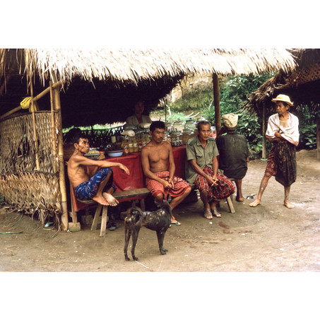 Villagers sitting food stall in front of