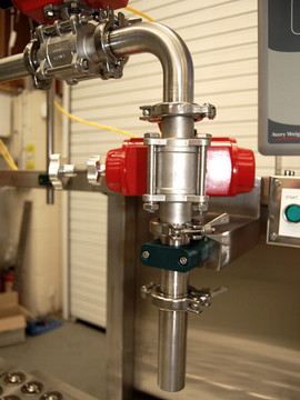 Twin head continuous flow Filling System