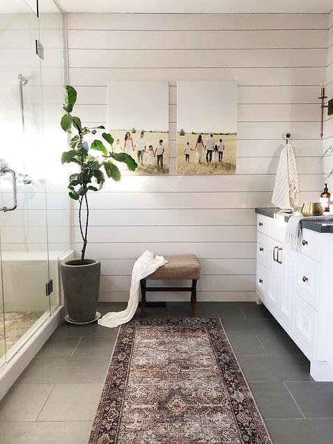 Lisa Clark Design Interior Design Steinbach shiplap oriental rug bathroom Winnipeg Manitoba white cabinets custom shower pebble floor brass sconce chrome faucet