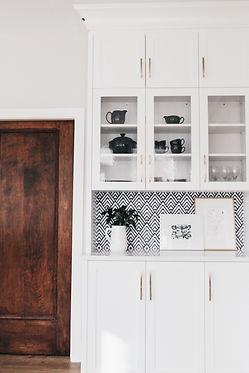 Lisa Clark Design Winnipeg Manitoba Interior Design dining room built-ins reclaimed doors gold hardware