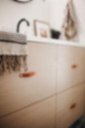 Lisa Clark Design Winnipeg Manitoba Interior Design Lisa Clark Design Brass hook bathroom cement floor floating vanity leather hardware
