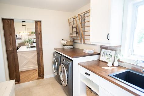Lisa Clark Design Winnipeg Manitoba Steinbach Interior Design farmhouse laundry wood countertops barn doors white cabinets