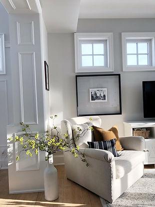 Lisa Clark Design Interior Design Steinbach Winnipeg Manitoba living room oriental rug armchair square window TV moulding
