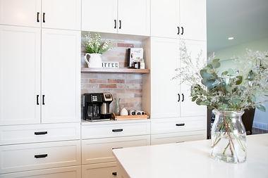 Lisa Clark Design Winnipeg Manitoba Steinbach Interior Design white kitchen farmhouse brick wall barn doors X coffee bar