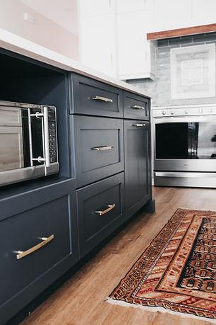 IMG_0718.JPGLisa Clark Design Winnipeg Manitoba Interior Design white kitchen blue island oriental rug blue backsplash gold hardware