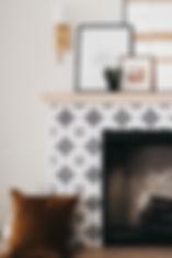 Lisa Clark Design Winnipeg Manitoba Interior Design cement tile brass sconces fireplace beams arched doors